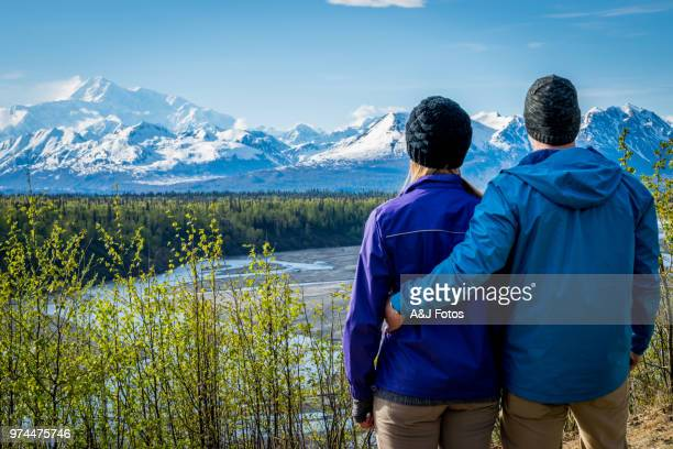 Young couple looking at mount Denali
