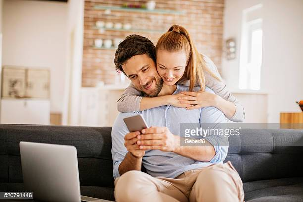 Young couple looking at smartphone