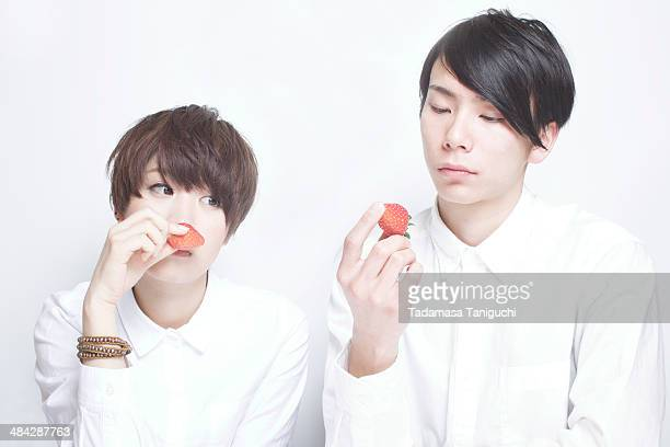 young couple looking at strawberry - bad bangs stock pictures, royalty-free photos & images