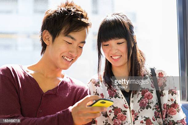 young couple looking at the cell phone