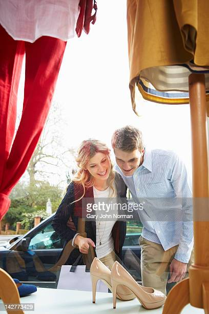 Young couple looking in window atBoutique shop