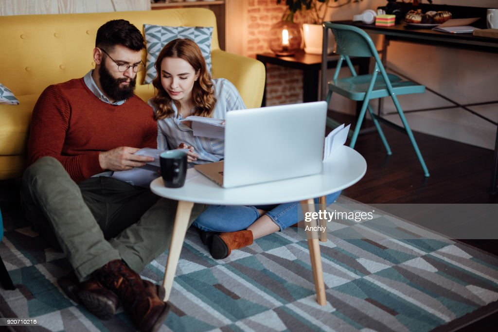 Young couple looking trough mail expecting new orders : Stock Photo