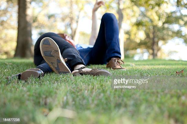 Young Couple Lounging in the Grass