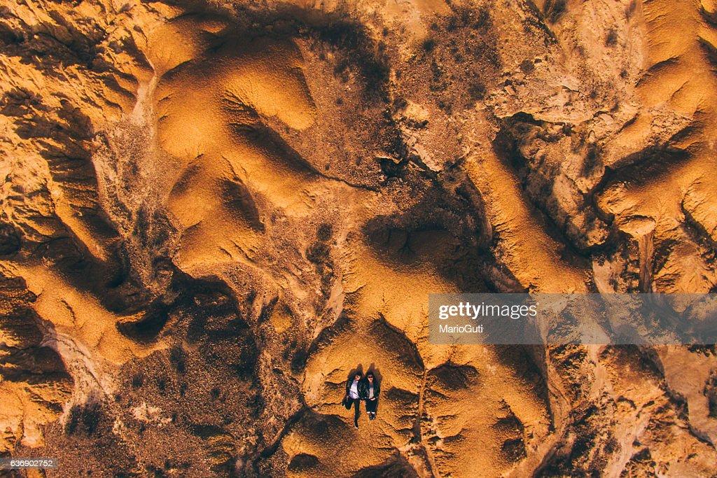 Young couple lying on desert : ストックフォト