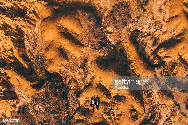 young couple lying on desert - adults only stock pictures, royalty-free photos & images