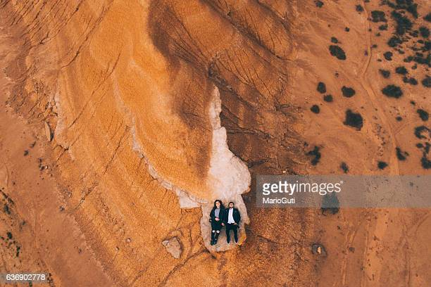 Young couple lying on desert