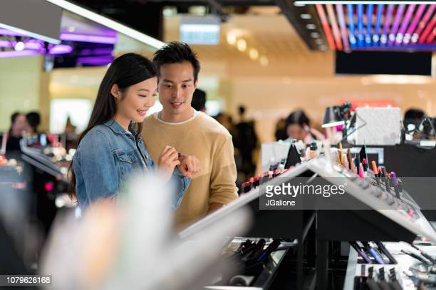 Young couple make up shopping together