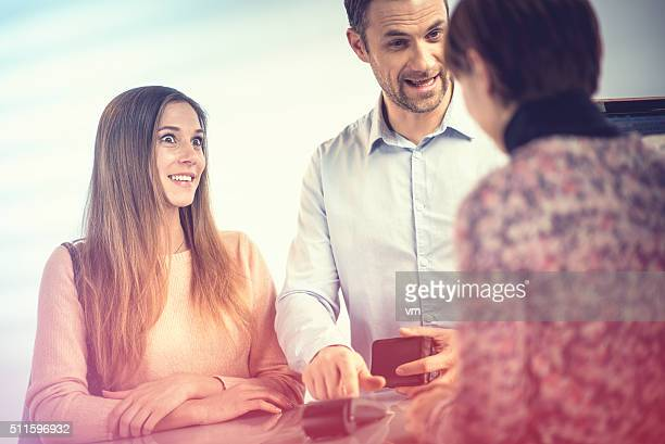 Young couple making a purchase