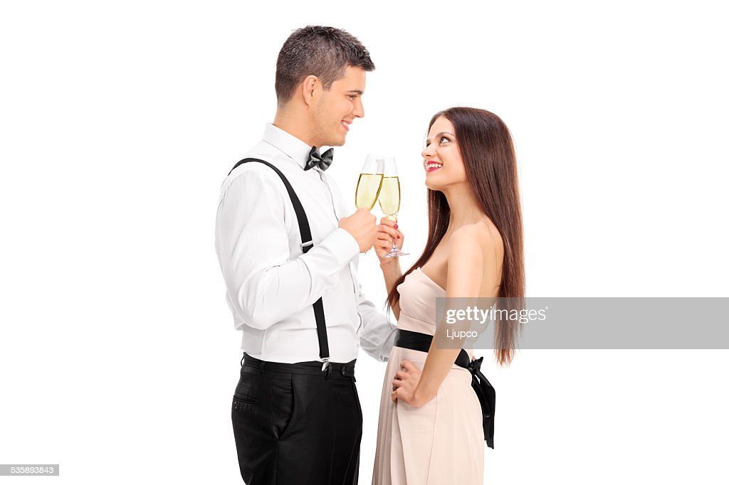 Young couple making a toast with wine : Stock Photo