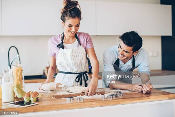 Young couple making cookies
