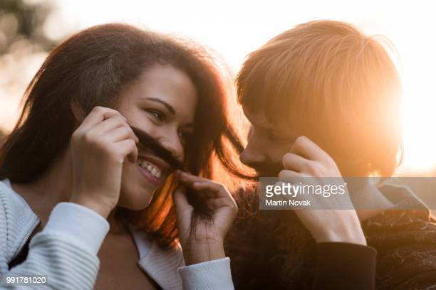 young couple making false mustache from hairs - teasing stock pictures, royalty-free photos & images