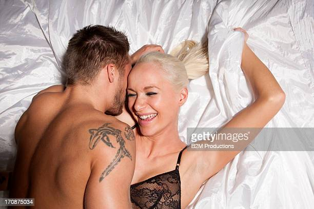 Young couple making love on bed