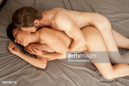 Young Couple Making Love On Bed Stock Photo  Getty Images-2990