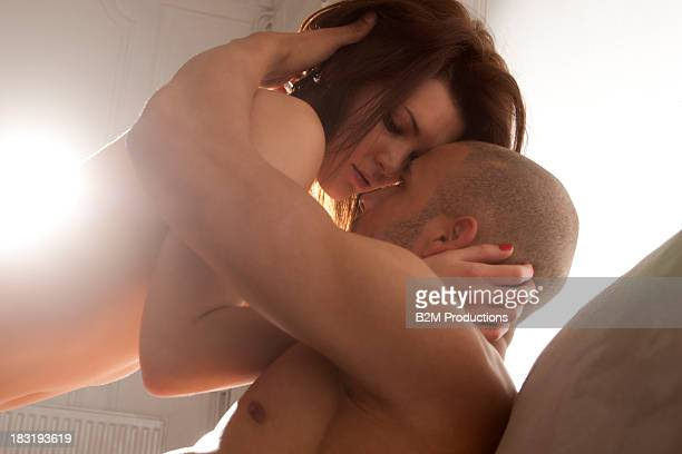 Young couple making love on couch