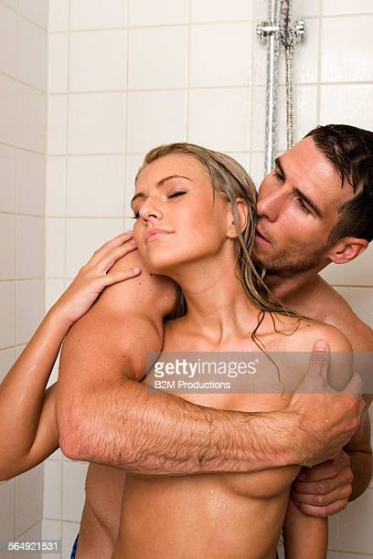 young couple making love - couples kissing shower stock pictures, royalty-free photos & images