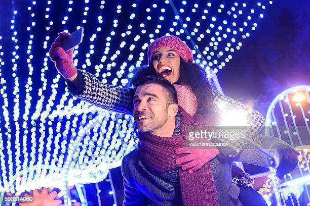 Young couple making selfie at night
