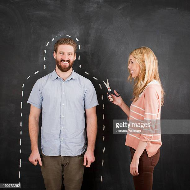 Young couple, man with chalk outline