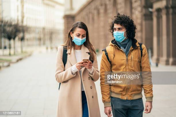 young couple meet in quarantine - respirator mask stock pictures, royalty-free photos & images