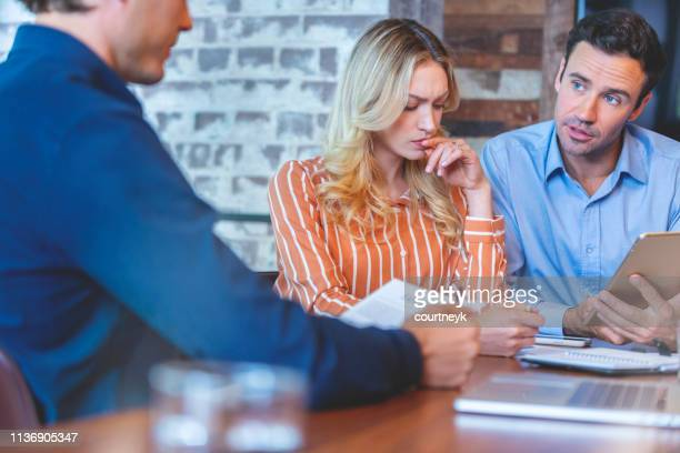 Young couple meeting with an advisor or business person.