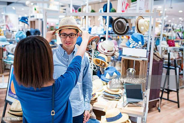 Young couple messing about in a department store