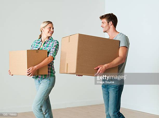 Young couple moving boxes