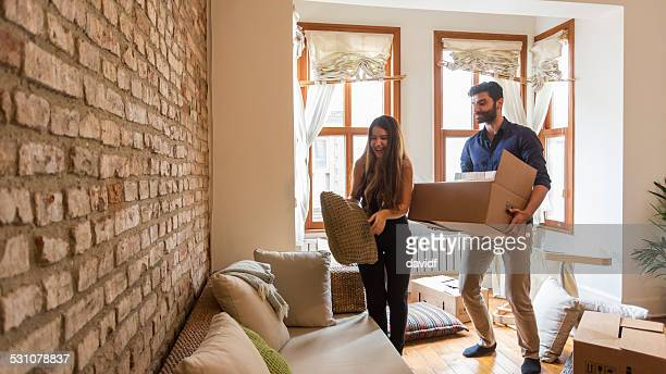 young couple moving house - muslim couple stock pictures, royalty-free photos & images