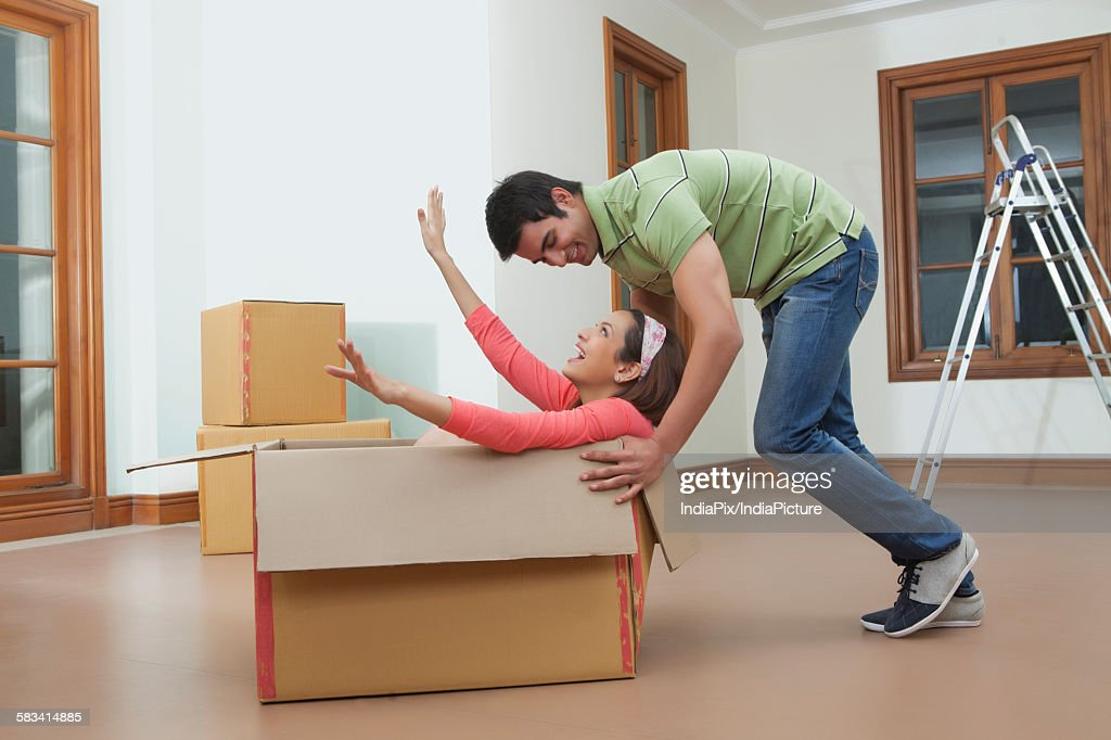 Young couple moving house : Stock Photo