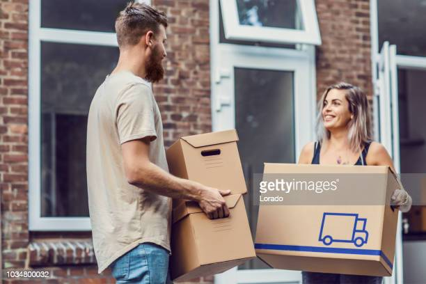 young couple moving into a new house - home ownership stock pictures, royalty-free photos & images