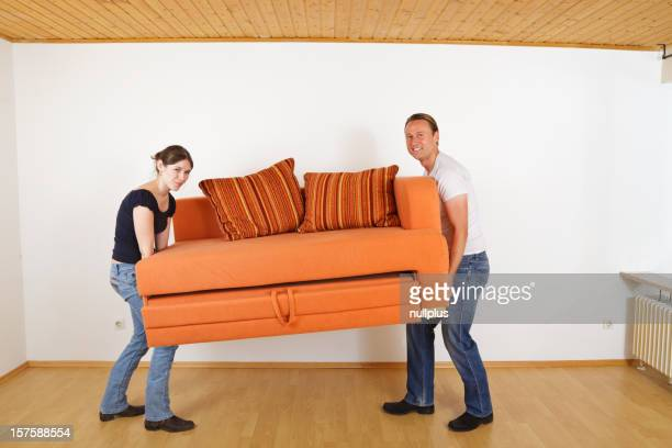 young couple moving into their new apartment