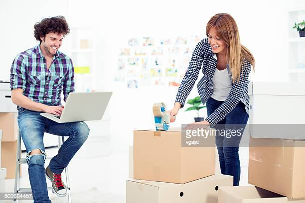Young couple moving to new apartment.