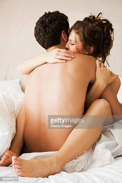 Young couple naked in bed.