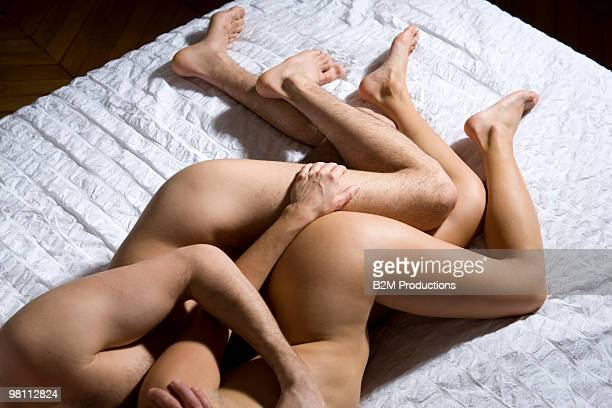 Young couple naked in bed