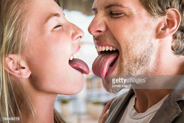 Young couple nervous to touch tongues