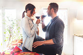 young couple lovers celebrating at home