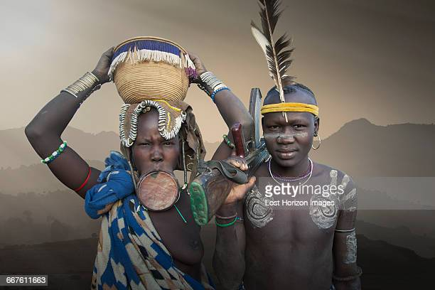 a young couple of the mursi tribe, omo valley, ethiopia - lip plate stock photos and pictures