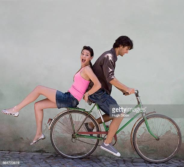 young couple on a bicycle - hugh sitton fotografías e imágenes de stock