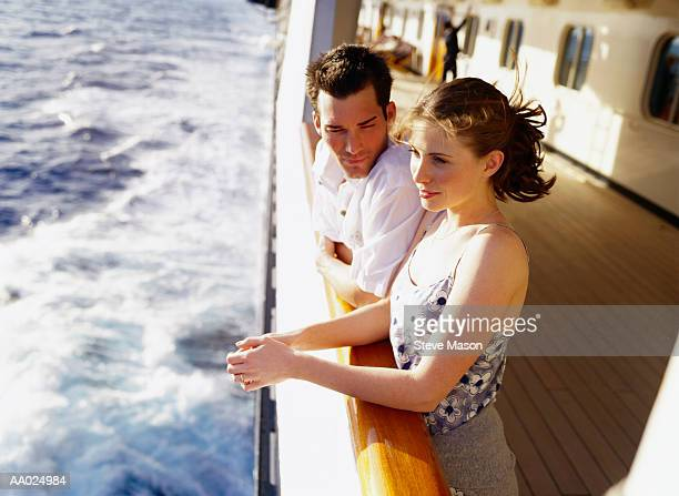 young couple on a cruise ship - cruise stock pictures, royalty-free photos & images