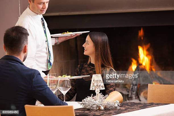 Young Couple on a Date getting Served