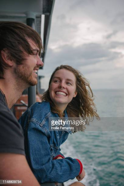 young couple on a ferry - ferry stock pictures, royalty-free photos & images