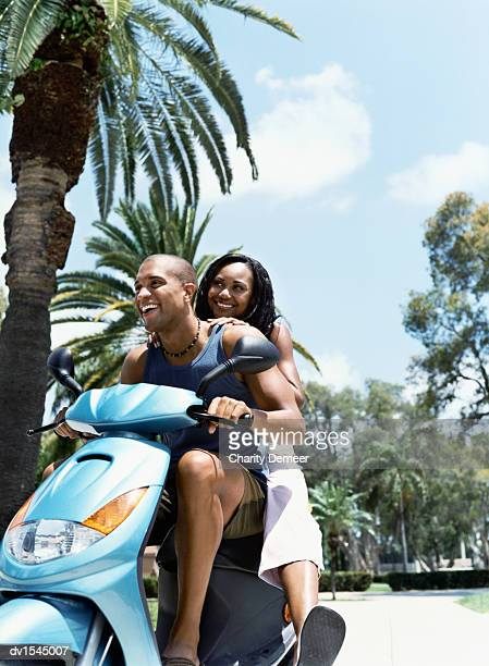 Young Couple on a Moped Together