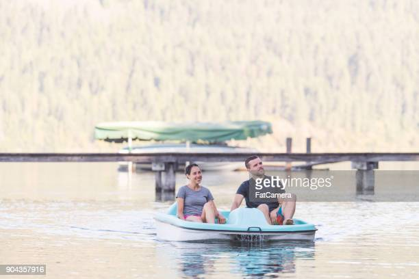 Young Couple on a Pedal Boat Paddle Around the Lake