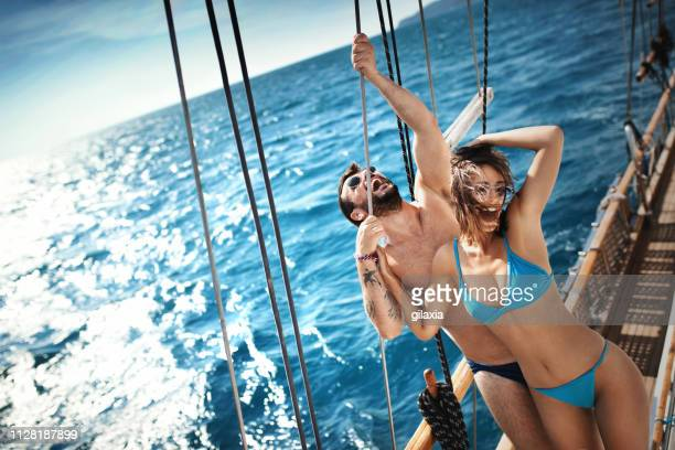 young couple on a sailing cruise. - adults only stock pictures, royalty-free photos & images
