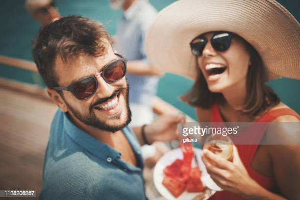 young couple on a sailing cruise. - high society stock pictures, royalty-free photos & images