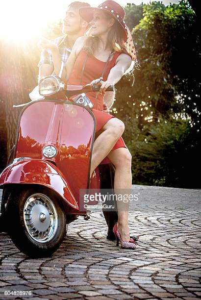 Young Couple on a Vintage Scooter