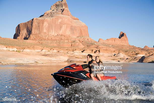 young couple on a wave runner