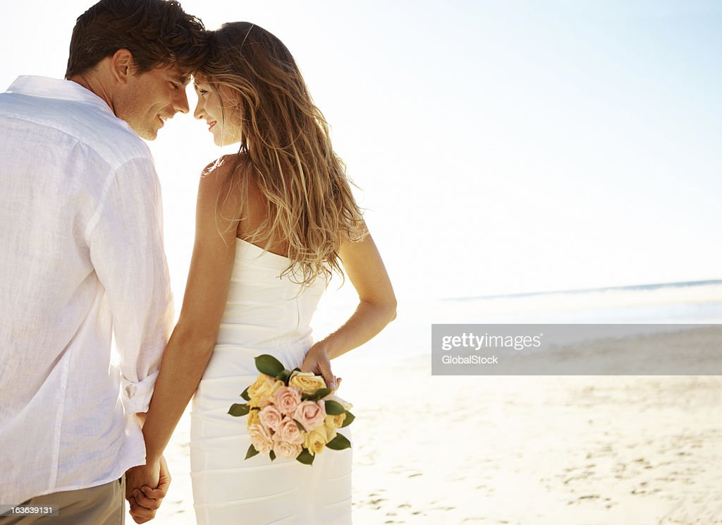 Young couple on beach : Stock Photo