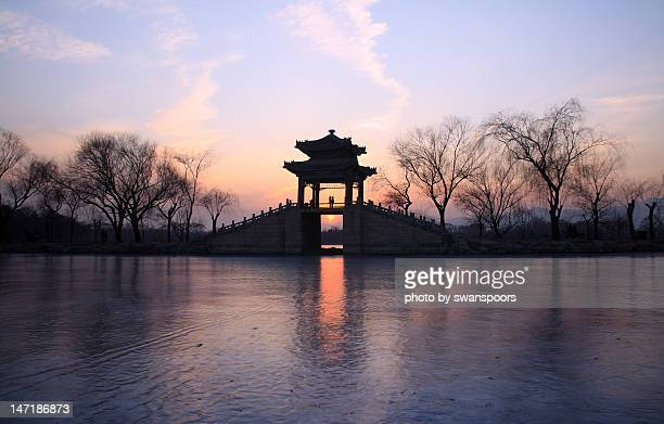 Young couple on bridge in summer palace