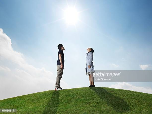 young couple on grassy hill