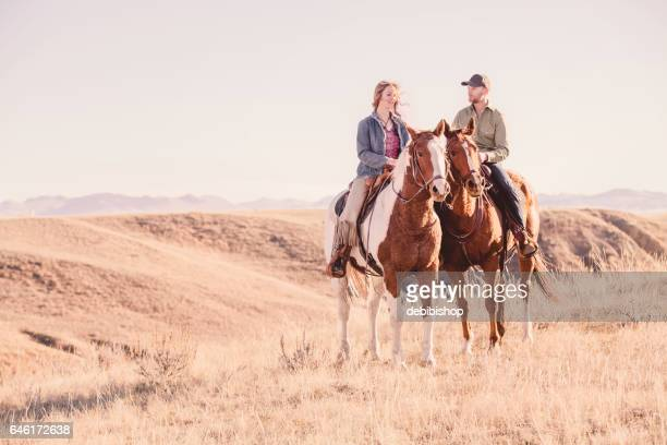 young couple on horseback - istock images stock pictures, royalty-free photos & images