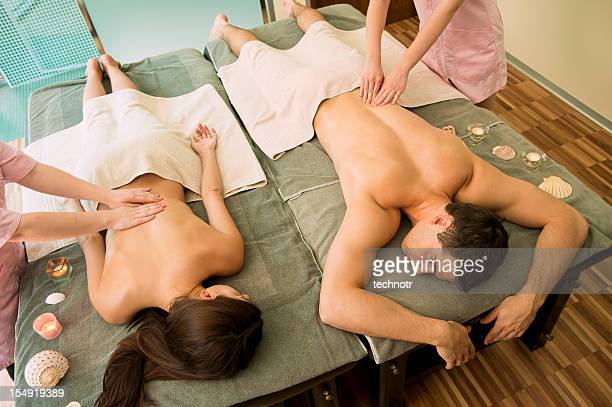 Young couple on massage table